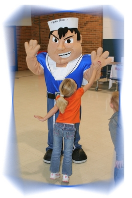 Sailor Mascot giving high five to student